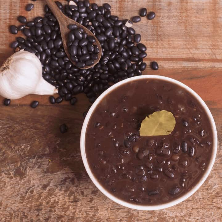 bowl of cooked black beans and ingredients
