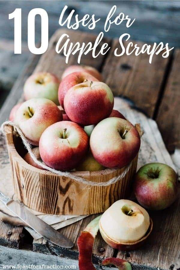 bucket of apples on a wooden cutting board with a knife